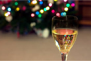 image of pretty lights and glass of white wine